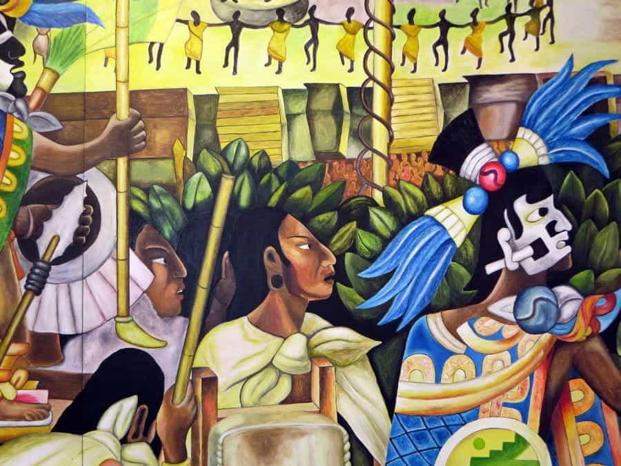 Lukisan dinding berwarna-warni di Meksiko yang menampilkan citra Aztec.