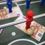 Table football and banknotes.