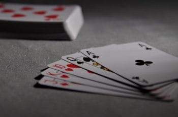A set of playing cards on a table.