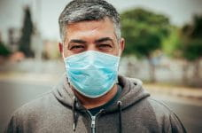 A man wears a protective face mask.
