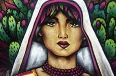 A mural of a woman wearing a head scarf in front of blooming cacti in San Pacho, Mexico.