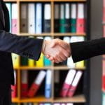 Two businesspeople shaking hands.