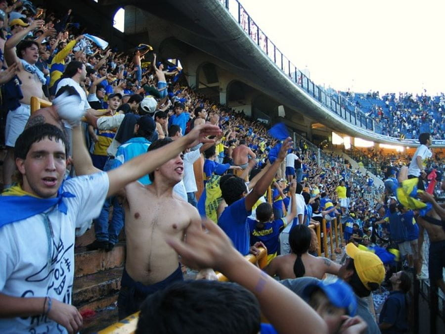 A packed stadium of enthusiastic soccer fans in Buenos Aires, Argentina.