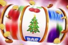 A slot machine with a Christmas tree icon.
