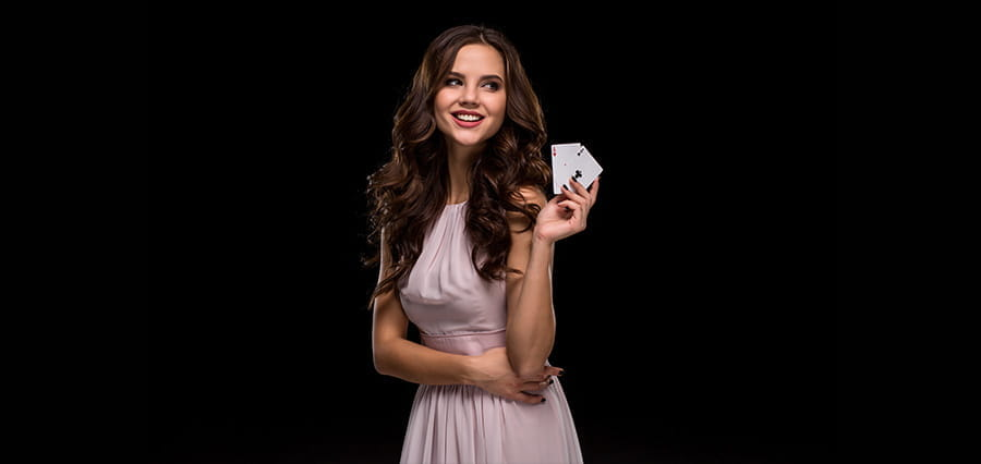 A woman holding playing cards.