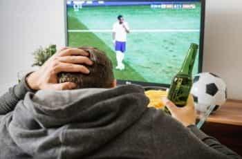 Football fan watching TV.