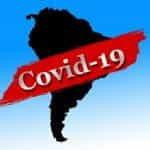 Siluet benua Amerika Latin dengan garis merah bertuliskan COVID-19.