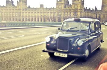 A London taxi passing Westminster.