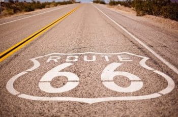 A highway in Nevada emblazoned with the logo for the historic Route 66.