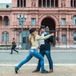 A couple performs a tango dance in front of the Casa Rosada in Buenos Aires, Argentina.