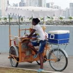 A woman sells ice from a cart in Panama.