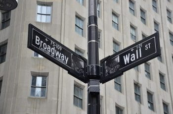 Street signs at the intersection of Broadway and Wall Street in New York City, New York.