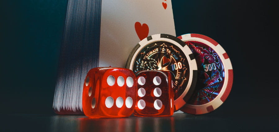 Poker chips, playing cards and dice.