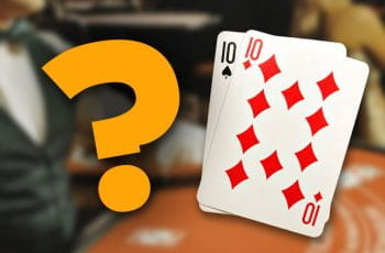A question mark next to playing cards - a pair of tens.