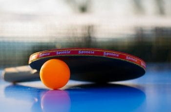 Table tennis paddle and ball.