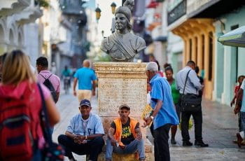 People walk through a plaza in the Dominican Republic.
