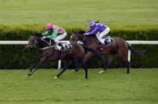 Horses racing.