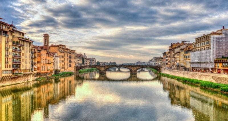 The Italian city of Florence in the Tuscany region, featuring its world-renowned bridges over the grand Arno river.
