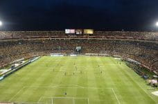 A crowded soccer stadium at night.