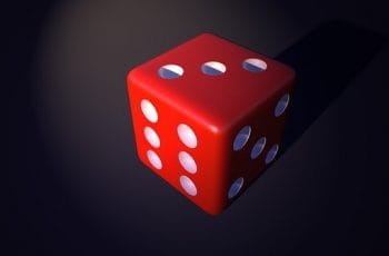 A red 3D dice on a black background.