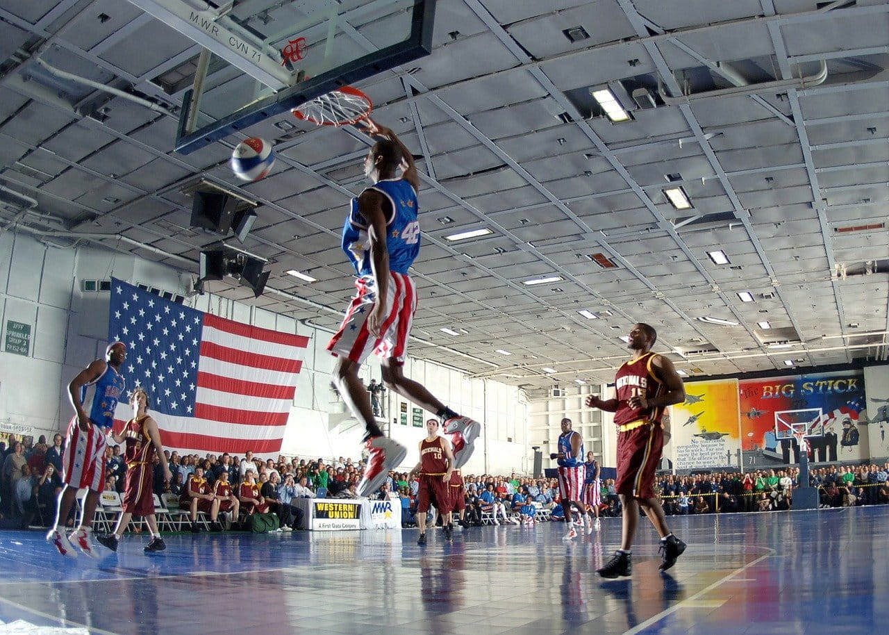 The Harlem Globetrotters play a basketball game on an American court.