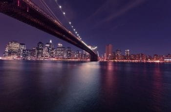 The Brooklyn Bridge at night in New York City, New York, US.
