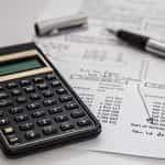 Calculator and balance sheet.