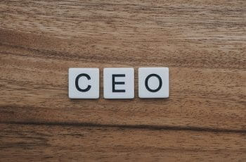 """The word """"CEO"""" in scrabble tiles."""