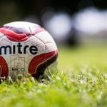 A football on the grass.