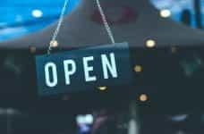 A shop door sign that says OPEN.