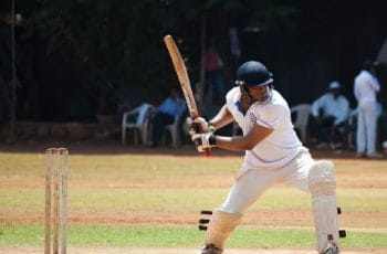 Cricket player swing.