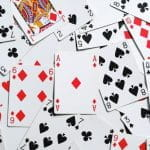 A pack of playing cards spread out on a table.