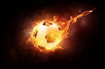 A football or soccer ball on fire.