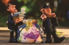 Small figurines policemen confiscating evidence such as laundered money and financial records.