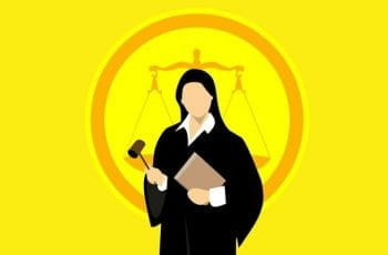 A graphic of a female judge standing before weighted scales.