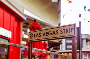 A small white sign reading Las Vegas Strip with an arrow.