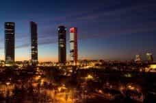 The city skyline of Madrid, Spain at night.
