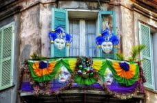Mardi Gras decorations on a balcony in New Orleans, Louisiana.