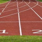 A track and field court, featuring two lanes with the numbers 1 and 2 on them.