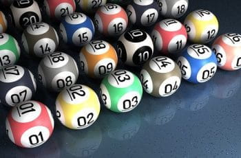 Multicolored bingo balls with numbers on.