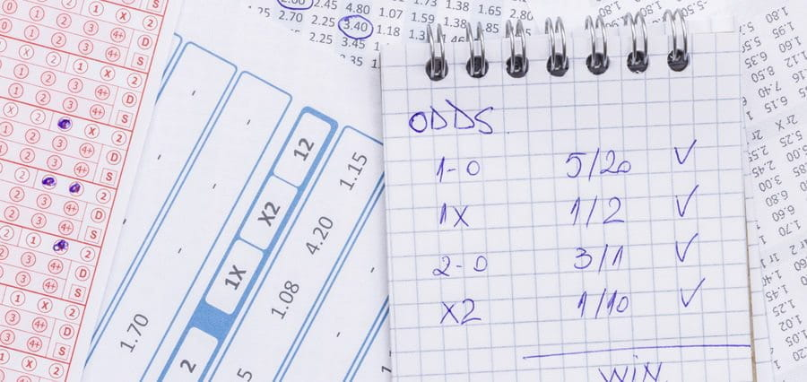 Odds written on sheets of paper.