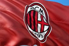 The flag and official logo of the football team AC Milan.