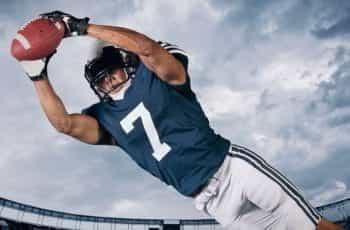 An American football player catching a ball.