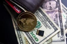 Ripple coin and US dollars.