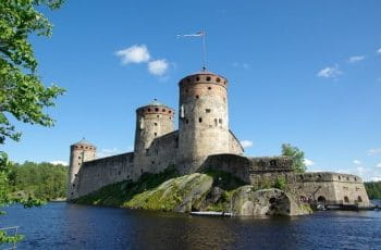 Finland Castle surrounded by water.