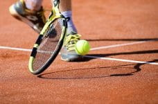 Men's single match on a clay court.